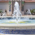 Fountain in Plaza de Panama, with the San Diego Museum of Art in the background.- El Prado
