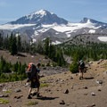 Following the North Fork of Whychus Creek toward Hayden Glacier. Middle Sister (10,047') and Prouty Point in the distance.- Middle Sister, East Approach