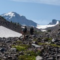 """Making our way up the """"funnel"""" to the base of Hayden Glacier. Middle Sister (10,047') and Prouty Point in the distance.- Middle Sister, East Approach"""