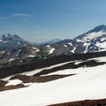 South Sister (10,358'), Broken Top (9,177'), and Mount Bachelor (9,068') seen from the ridge beside Hayden Glacier.- Middle Sister, East Approach