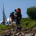 Climbing up a cinder hill with Middle Sister (10,047') in the background.- Middle Sister, East Approach