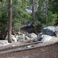 The approach to a typical site includes a few stairs.- Whitney Portal Campground