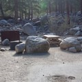 A typical site in Whitney Portal Campground includes a picnic table and a bear-proof locker.- Whitney Portal Campground