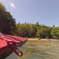 Coming in for a landing on the west side of Baker Lake.- Baker Lake Sea Kayaking