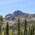 Sierra Buttes as seen form the road leading up to Packer Saddle. The fire lookout tower is perched on the summit.- Sierra Buttes Trail