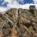 Steep metal stairs lead up the summit block to the lookout.- Sierra Buttes Fire Lookout