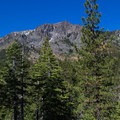 Tallac's summit rises high above treeline and the trail leading up to Cathedral Lake.- Cathedral Lake