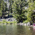 Cathedral Lake's shallow warmer waters beckon to swimmers.- Cathedral Lake