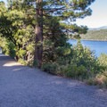 A mile-long trail leads down to the Emerald Bay beaches and Vilkingsholm.- Emerald Bay State Park