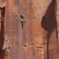Climber on a wall adjacent to Angels Landing.- Angels Landing Hike