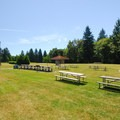 Group picnic area and lawn next to the seminary building.- Saint Edward State Park