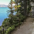 Beyond Rubicon Point the trail hugs steep cliffs hundreds of feet above Lake Tahoe.- Rubicon Trail