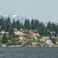 Looking east across Lake Washington toward the North Cascades with Mount Index (5,991').- Matthews Beach Park