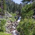 The trail to Eagle Lake follows Eagle Creek, crossing at Upper Eagle Falls.- Eagle Lake
