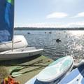Boats at the Green Lake Boat Rental on the lake's northeastern shore.- Green Lake