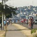 View of the Alki Trail with Seattle's Queen Ann neighborhood in the distance.- Alki Trail