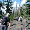 For an easy adventure, follow an old wagon road cut into the lava flow.- Hand Lake