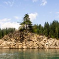 One of three small, rocky islands in the bay near Alder Lake Park.- Alder Lake