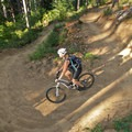 The lower section of Highballer has numerous smooth, banked, hairpin turns.- Alsea Flow Trails