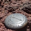 A USGS marker is drilled into a bit of solid rock near the summit of Scott Mountain.- Scott Mountain