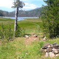 A firepit near the shelter provides a nice view of the lake and Mount Washington (7,795').- Hand Lake