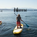Stand-up paddleboarding is a popular activity in the area.- Golden Gardens to West Point Lighthouse Sea Kayaking
