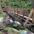 The trail includes a log bridge with handrails to cross over Deception Creek.- Deception Falls Interpretive Trail