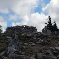 At the summit, a stout windbreak makes a nice resting spot.- Bear Point