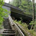 Stair access under Stevens Pass to view the upper falls.- Deception Falls Interpretive Trail