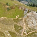 A hiker navigates switchbacks on the way down.- Maple Pass Loop Hike