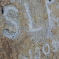 1909 initials from a 20th-century canyon regular, S.L. Foster, found on a ledge above the first rappel point. Please do not follow suit.- Tenaya Canyon Descent