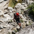 Rapping 70 feet into the lower section of the Inner Gorge off the third rappel.- Tenaya Canyon Descent