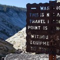 A sign warns causual hikers of the terrain that lies ahead.- Tenaya Canyon Descent