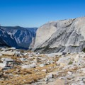 Reaching Lone Boulder (right) with the floor of Yosemite Valley, Half Dome, and Mount Watkins in view.- Tenaya Canyon Descent