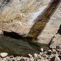 A welcome pool located below the rock slab descent area. - Tenaya Canyon Descent