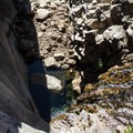 Tenaya Creek plummets 40 feet over the ledge. This drop marks the beginning of the Inner Gorge.- Tenaya Canyon Descent