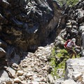 Rapping into the Inner Gorge off the first set of rappel anchors.- Tenaya Canyon Descent