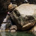 Rapping Leconte Boulder. The right side appears to be downclimbable.- Tenaya Canyon Descent