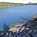 The clear water of Waldo Lake is a brilliant blue  in the sunlight.- Waldo Lake Trail