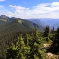 The summit view east with the trail in the foreground.- Beckler Peak Trail