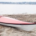 A kayak sits on the shores of Lake Washington at Denny Park.- North Lake Washington Sea Kayaking Loop