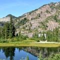 Mount Herman (6,244') reflected in Terminal Lake.- Chain Lakes Loop Trail