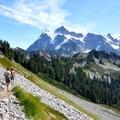 Hikers on the Chain Lakes Trail beneath Mount Shuksan (9,131').- Chain Lakes Loop Trail