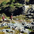 Backpackers climbing to Herman Saddle.- Chain Lakes Loop Trail