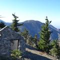 An old fire lookout cabin on Mount Islip's summit.- Mount Islip Loop Trail