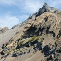 One last view of Mount Thielsen's heavily eroded west face from the west ridge.- Mount Thielsen