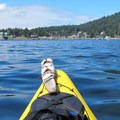 Paddling in the East Sound toward Rosario Resort.- Orcas Island: Sea Kayaking Obstruction Pass Beach to Cascade Bay