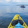 Launching kayaks from Orcas Island on the way to Sucia Island.- Orcas Island to Sucia Island Sea Kayaking