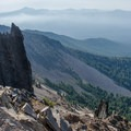 Interesting rock formations along the south ridge. The rim of Crater Lake is visible in the distance.- Mount Thielsen