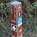 Trail markers along the Sucia Island Trail.- Sucia Island Hiking Trail System